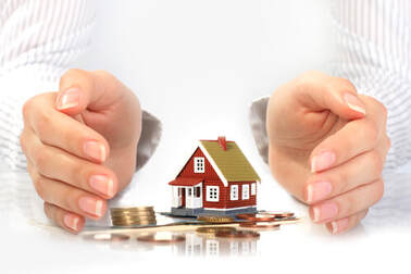 Hands protecting home investment