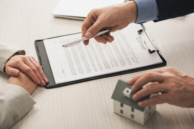 man and woman reviewing a real estate contract