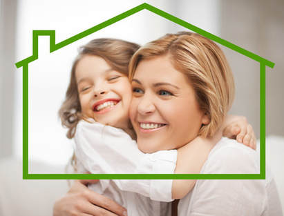 Mother and daughter hugging framed by house outline